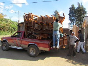 ..the neighbor makes beautiful tables and chairs...how many tables and chairs are on this truck headed for the city????
